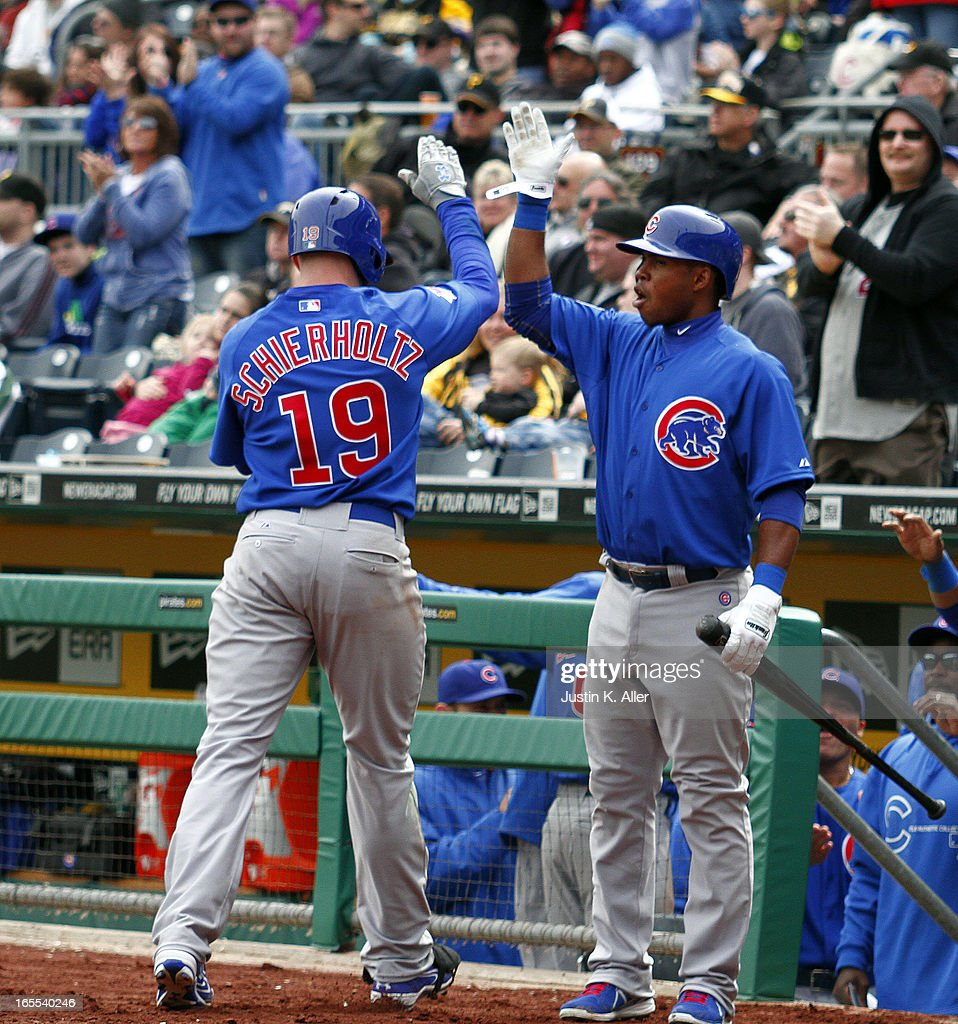 Nate Schierholtz #19 of the Chicago Cubs celebrates after hitting a two run home run in the ninth inning against the Pittsburgh Pirates during the game on April 4, 2013 at PNC Park in Pittsburgh, Pennsylvania. The Cubs defeated the Pirates 3-2.