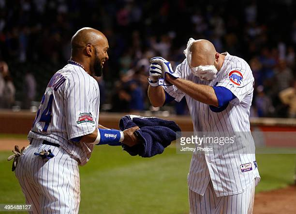 Nate Schierholtz of the Chicago Cubs gets a pie in the face by Emilio Bonifacio of the Chicago Cubs after Schierholtz' gamewinning hit against the...