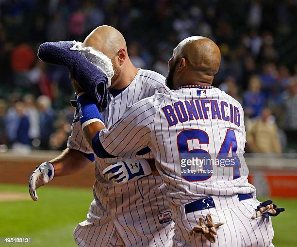 Nate Schierholtz of the Chicago Cubs gets a pie in the face by Emilio Bonifacio of the Chicago Cubs after Schierholtz' game-winning hit against the...