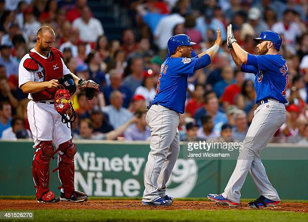 Nate Schierholtz of the Chicago Cubs is congratulated by teammate Welington Castillo after hitting a tworun home run in the fourth inning against the...