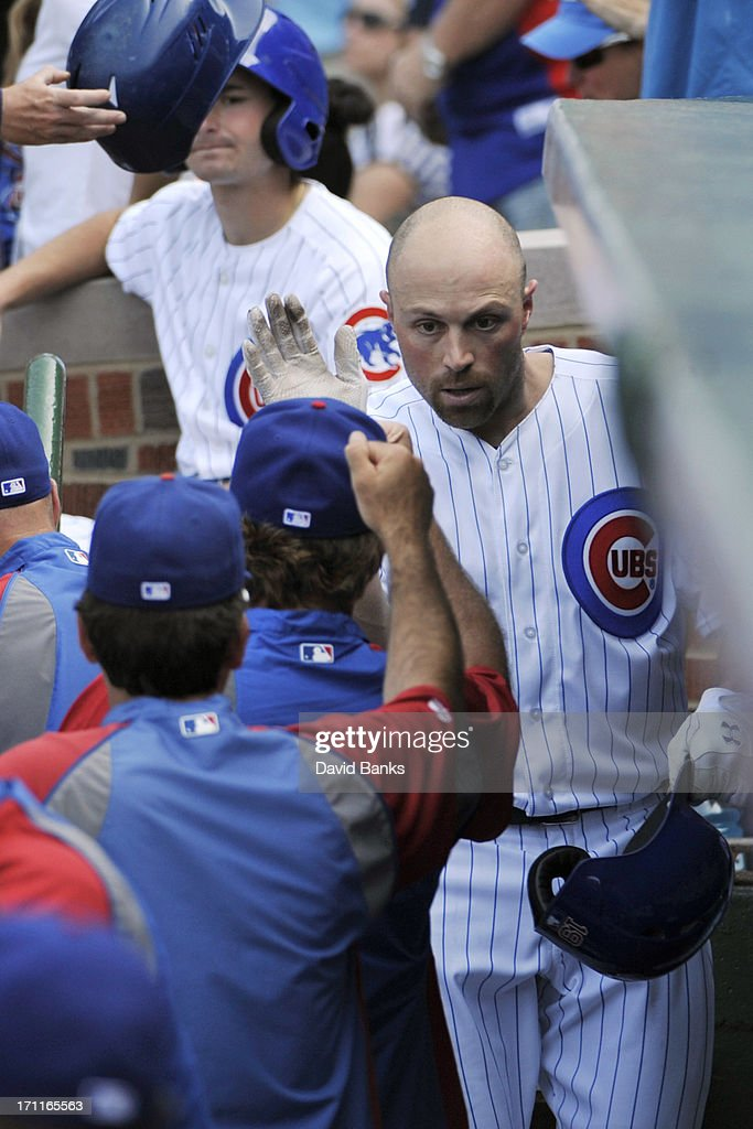 Nate Schierholtz #19 of the Chicago Cubs is greeted by teammates after hitting a home run against the Houston Astros during the fifth inning on June 22, 2013 at Wrigley Field in Chicago, Illinois.