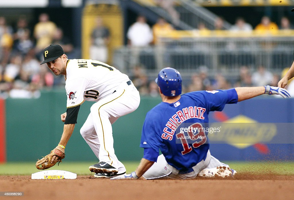 Nate Schierholtz #19 of the Chicago Cubs stretches a single into a double in the fifth inning against Jordy Mercer #10 of the Pittsburgh Pirates during the game at PNC Park on June 9, 2014 in Pittsburgh, Pennsylvania.