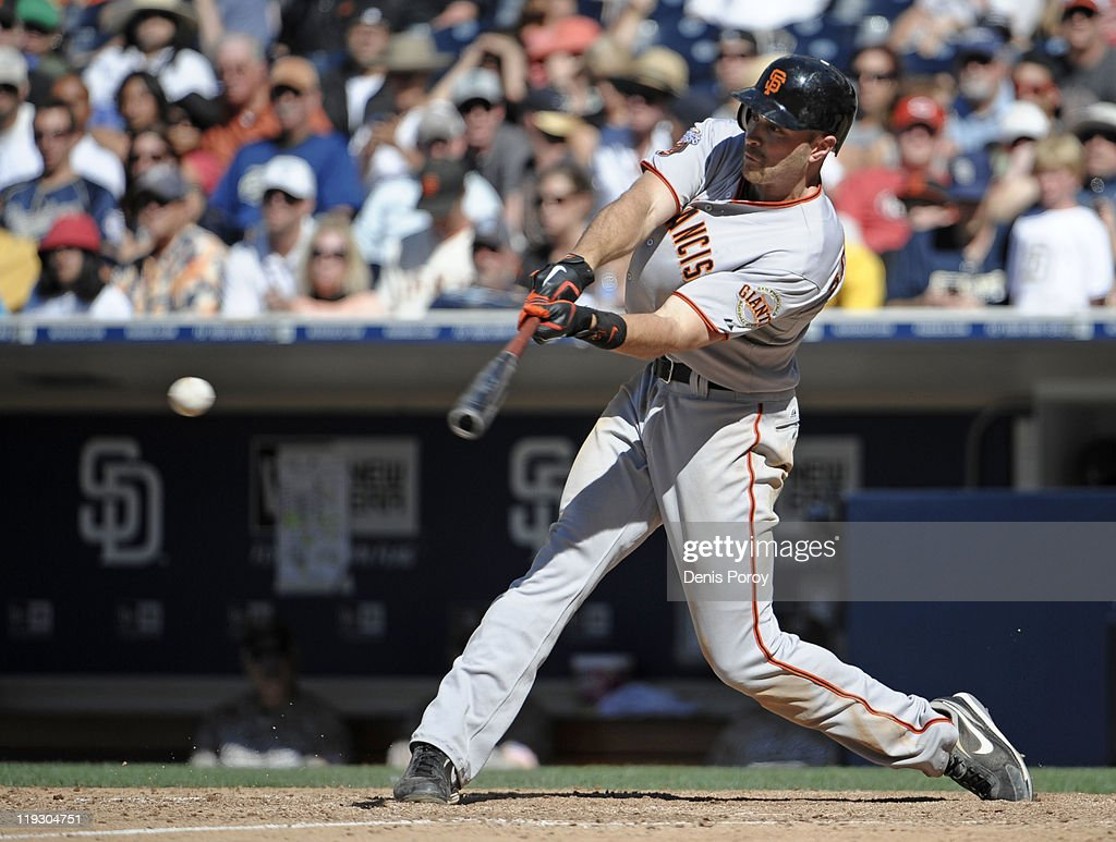 Nate Schierholtz #12 of the San Francisco Giants hits an RBI single during the fourth inning of a baseball game against the San Diego Padres at Petco Park on July 17, 2011 in San Diego, California.