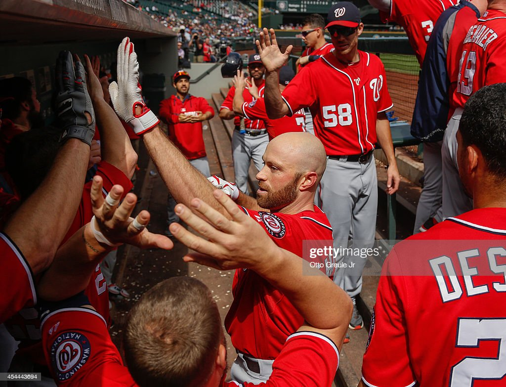Nate Schierholtz #17 of the Washington Nationals is congratulated by teammates after hitting a home run in the third inning against the Seattle Mariners at Safeco Field on August 31, 2014 in Seattle, Washington. The Mariners defeated the Nationals 5-3.