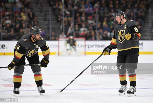 Nate Schmidt and Deryk Engelland of the Vegas Golden Knights talk during a stoppage in play during the first period against the Minnesota Wild at...