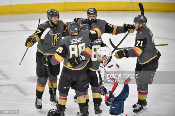 Nate Schmidt celebrates his goal with teammates Shea Theodore Jonathan Marchessault William Karlsson and Reilly Smith of the Vegas Golden Knights...