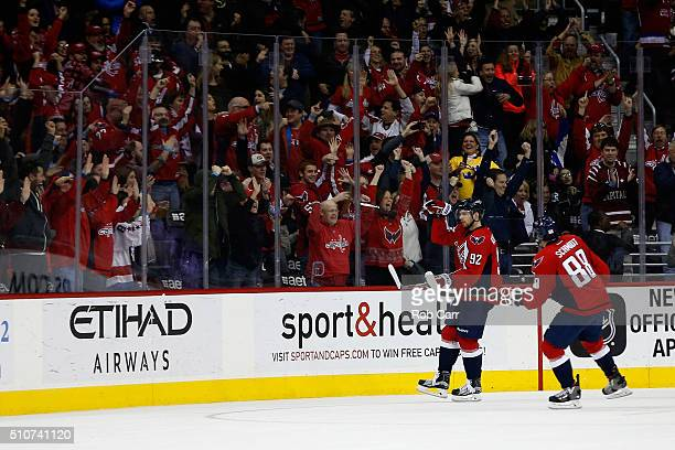 Nate Schmidt looks on as teammate Evgeny Kuznetsov of the Washington Capitals celebrates after scoring a third period goal against the Los Angeles...