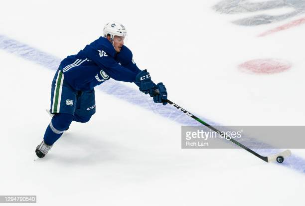 Nate Schmidt of the Vancouver Canucks reaches for the puck on the first day of the Vancouver Canucks NHL Training Camp on January 2021 at Rogers...