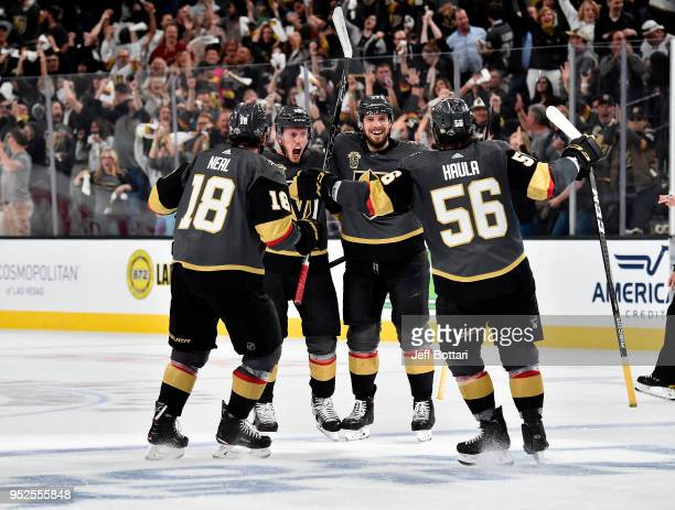 Nate Schmidt of the Vegas Golden Knights celebrates with his teammates James Neal Shea Theodore and Erik Haula after scoring a goal against the San...