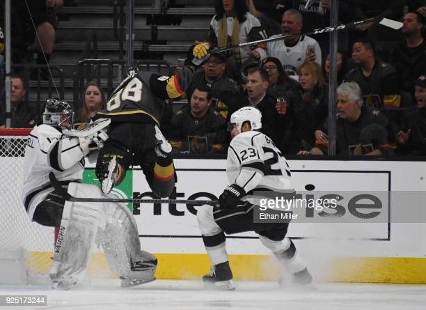 Nate Schmidt of the Vegas Golden Knights crashes into Jack Campbell of the Los Angeles Kings as Dustin Brown of the Kings looks on in the first...