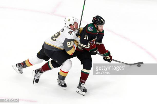 Nate Schmidt of the Vegas Golden Knights hits Taylor Hall of the Arizona Coyotes in the first period during an exhibition game prior to the 2020 NHL...