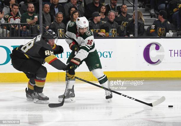Nate Schmidt of the Vegas Golden Knights passes under pressure from Jason Zucker of the Minnesota Wild in the first period of their game at TMobile...