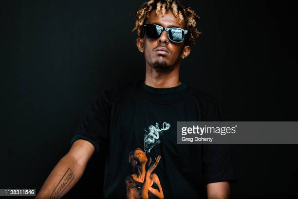 Nate Selassie wearing a Cannacity Shirt Design with Photography by Michael Bezjian attends the Welcome to Cannacity 'She's Smokin' Event on April 20...