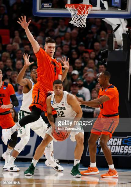 Nate Sestina of the Bucknell Bison guards G Miles Bridges of the Michigan State Spartans during the NCAA Division I Men's Basketball Championship...