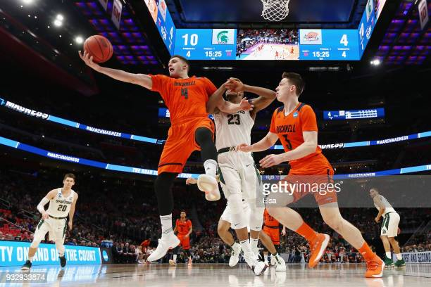 Nate Sestina of the Bucknell Bison handles the ball during the first half against the Michigan State Spartans in the first round of the 2018 NCAA...