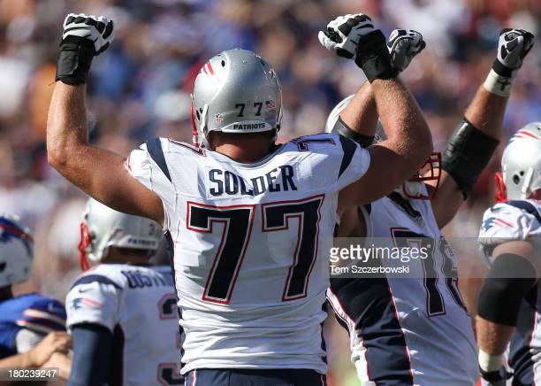 Nate Solder of the New England Patriots and Sebastian Vollmer celebrate the gamewinning kick by Stephen Gostkowski during NFL game action against the...