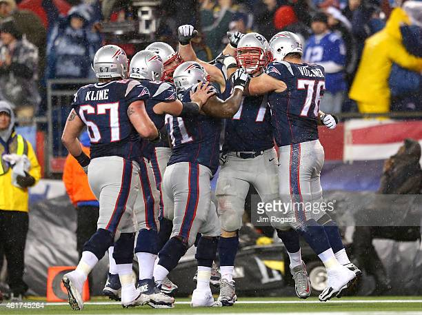 Nate Solder of the New England Patriots celebrates with teammates after scoring a touchdown in the third quarter against the Indianapolis Colts of...