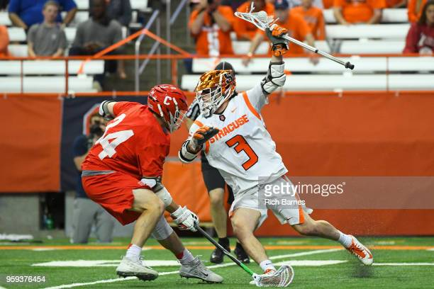 Nate Solomon of the Syracuse Orange dodges to the goal against the defense of Jake Pulver of the Cornell Big Red during a 2018 NCAA Division I Men's...