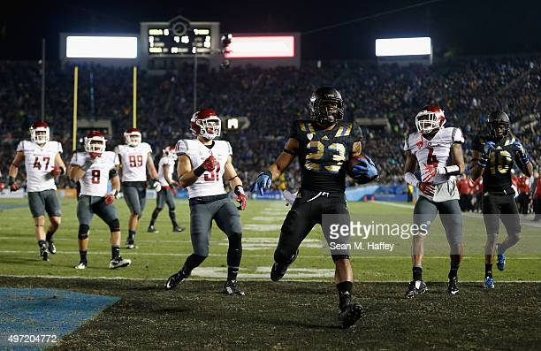Nate Starks of the UCLA Bruins eludes Charleston White of the Washington State Cougars Isaac Dotson of the Washington State Cougars Jeremiah Allison...