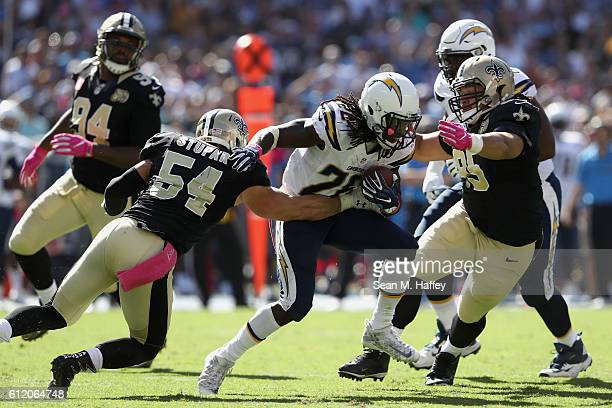 Nate Stupar and Tyeler Davison of the New Orleans Saints try to stop Melvin Gordon of the San Diego Chargers during a first half run at Qualcomm...
