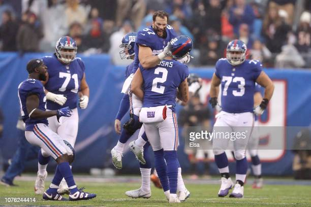 Nate Stupar congratulates Aldrick Rosas of the New York Giants on his field goal against the Chicago Bears at MetLife Stadium on December 02 2018 in...