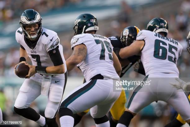 Nate Sudfeld of the Philadelphia Eagles drops back as Brandon Brooks and Lane Johnson block during the preseason game against the Pittsburgh Steelers...