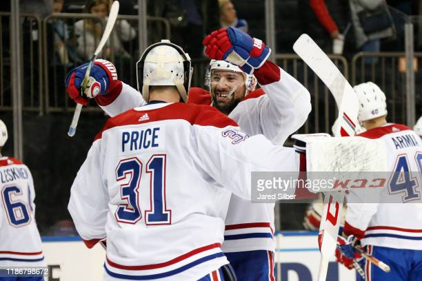 Nate Thompson and Carey Price of the Montreal Canadiens celebrate after defeating the New York Rangers 21 at Madison Square Garden on December 6 2019...