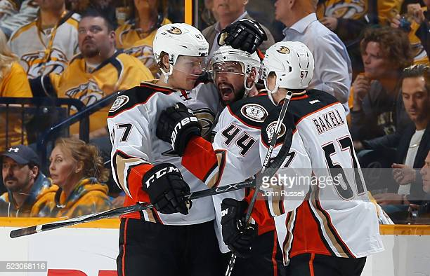 Nate Thompson celebrates his goal with Hampus Lindholm and Rickard Rakell of the Anaheim Ducks against the Nashville Predators in Game Four of the...