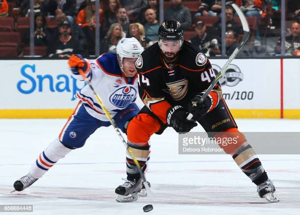 Nate Thompson of the Anaheim Ducks battles for the puck against Drake Caggiula of the Edmonton Oilers during the game on March 22 2017 at Honda...