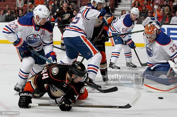 Nate Thompson of the Anaheim Ducks battles for the puck against Matt Hendricks and Cam Talbot of the Edmonton Oilers on February 26 2016 at Honda...