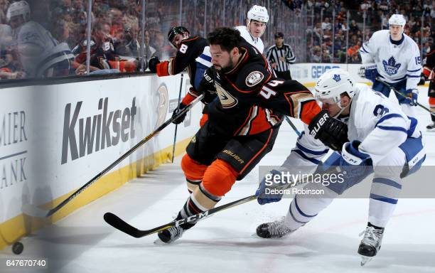 Nate Thompson of the Anaheim Ducks battles for the puck against Alexey Marchenko of the Toronto Maple Leafs on March 3 2017 at Honda Center in...