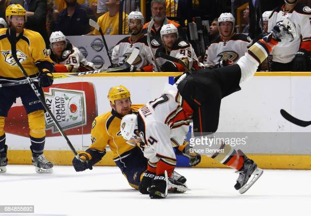Nate Thompson of the Anaheim Ducks falls as Cody McLeod of the Nashville Predators looks on during the first period in Game Four of the Western...