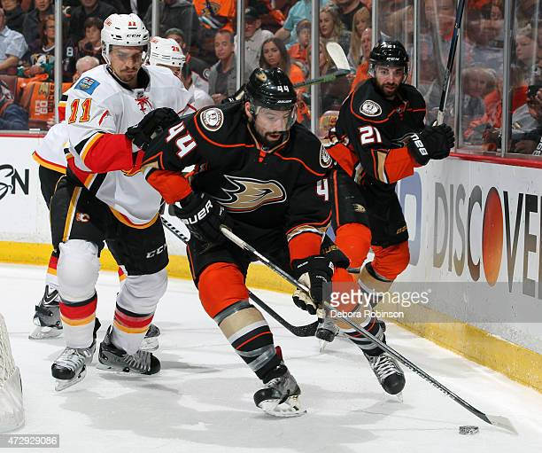 Nate Thompson of the Anaheim Ducks handles the puck against Mikael Backlund of the Calgary Flames in Game Five of the Western Conference Semifinals...