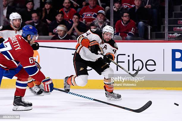 Nate Thompson of the Anaheim Ducks passes the puck in front of Max Pacioretty of the Montreal Canadiens during the NHL game at the Bell Centre on...
