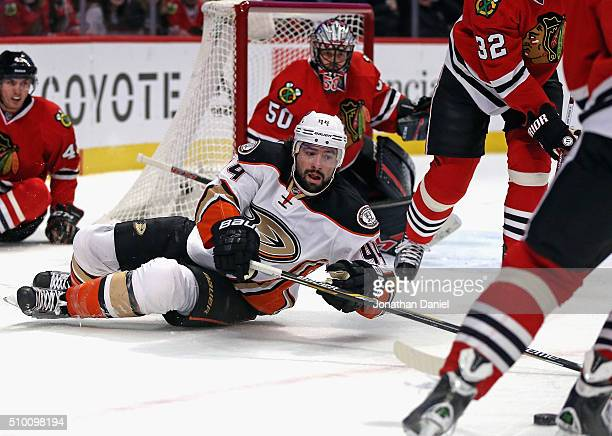 Nate Thompson of the Anaheim Ducks reaches for the puck after falling to ice in front of Viktor Svedberg of the Chicago Blackhawks at the United...