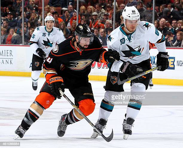 Nate Thompson of the Anaheim Ducks skates against Matt Tennyson of the San Jose Sharks on December 31 2014 at Honda Center in Anaheim California