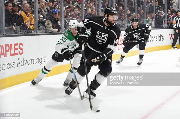 Nate Thompson of the Los Angeles Kings handles the puck against Marc Methot of the Dallas Stars at STAPLES Center on February 22 2018 in Los Angeles...