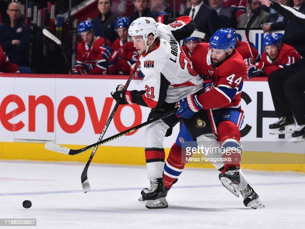 Nate Thompson of the Montreal Canadiens challenges Logan Brown of the Ottawa Senators during the first period at the Bell Centre on December 11 2019...