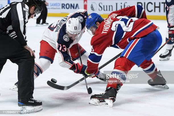 Nate Thompson of the Montreal Canadiens faces off against Cam Atkinson of the Columbus Blue Jackets in the NHL game at the Bell Centre on February 19...