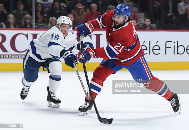 Nate Thompson of the Montreal Canadiens fires a shot against the Tampa Bay Lightning in the NHL game at the Bell Centre on April 2 2019 in Montreal...