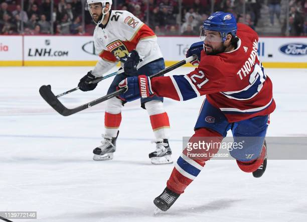 Nate Thompson of the Montreal Canadiens fires a slap shot against the Florida Panthers in the NHL game at the Bell Centre on March 26 2019 in...