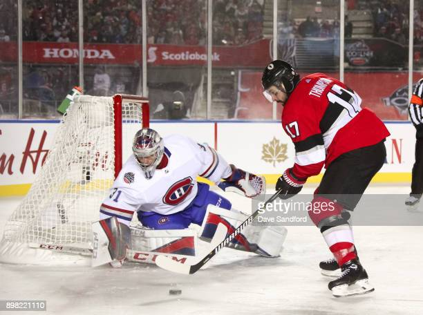 Nate Thompson of the Ottawa Senators carries the puck in on Carey Price of the Montreal Canadiens during the 2017 Scotiabank NHL100 Classic at...