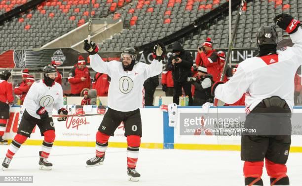 Nate Thompson of the Ottawa Senators celebrates a goal with teammates Tom Pyatt and Gabriel Dumont during practice at Lansdowne Park on December 15...