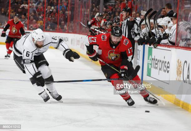 Nate Thompson of the Ottawa Senators controls the puck along the boards against Jake Muzzin of the Los Angeles Kings at Canadian Tire Centre on...