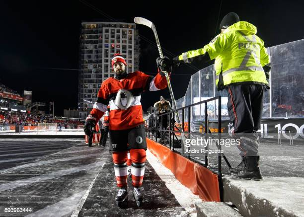 Nate Thompson of the Ottawa Senators highfives an Ottawa police officer prior to playing against the Montreal Canadiens in the 2017 Scotiabank NHL100...