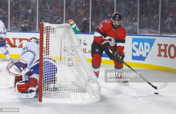 Nate Thompson of the Ottawa Senators skates with the puck behind the net guarded by Carey Price of the Montreal Canadiens during the third period of...