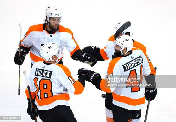 Nate Thompson of the Philadelphia Flyers is congratulated by teammates Ivan Provorov,Matt Niskanen and Tyler Pitlick after Thompson scored an...