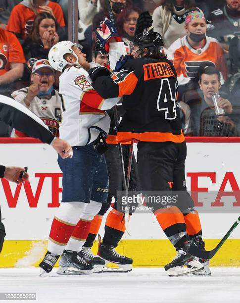 Nate Thompson of the Philadelphia Flyers scuffles with Patric Hornqvist of the Florida Panthers at the Wells Fargo Center on October 23, 2021 in...