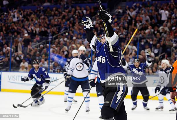Nate Thompson of the Tampa Bay Lightning celebrates after scoring a goal during the second period against the Winnipeg Jets at Tampa Bay Times Forum...