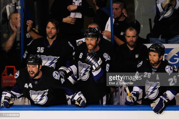 Nate Thompson Ryan Malone and Martin St Louis of the Tampa Bay Lightning celebrate a second period goal against the Boston Bruins in Game Four of the...
